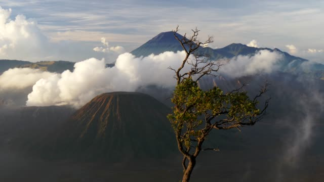 Smoke-comes-from-the-Mount-Bromo-which-is-an-active-volcano-and-is-located-in-Bromo-Tengger-Semeru-National-Park-East-Java-Indonesia