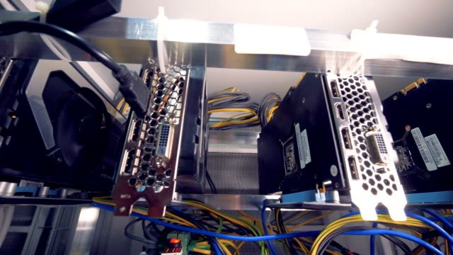 Motion-footage-of-bitcoin-mining-process-held-by-a-row-of-graphic-processing-units