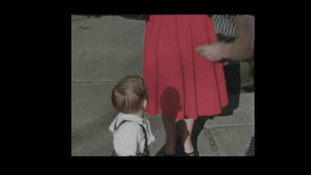 1954-Grandmother-gives-grandson-bite-of-apple