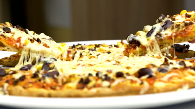 Two-Hands-Take-Hot-Pizza-With-Melted-Cheese