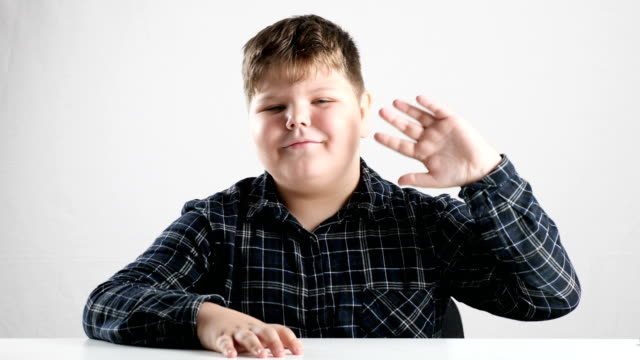 Young-fat-boy-waving-his-arm-hello-sign-50-fps