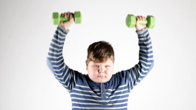 Young-fat-boy-does-the-exercise-with-dumbbells-pumps-the-shoulders-50-fps