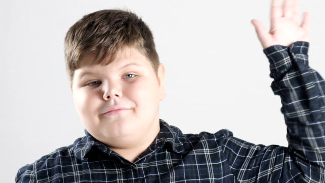 Young-fat-boy-showing-hello-sign-50-fps