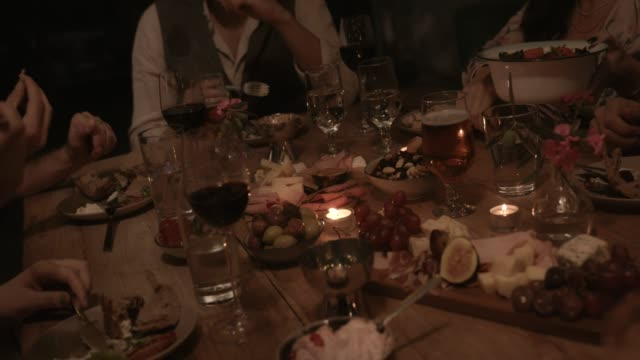 Young-friends-and-couples-having-dinner-party-with-mediterranean-food