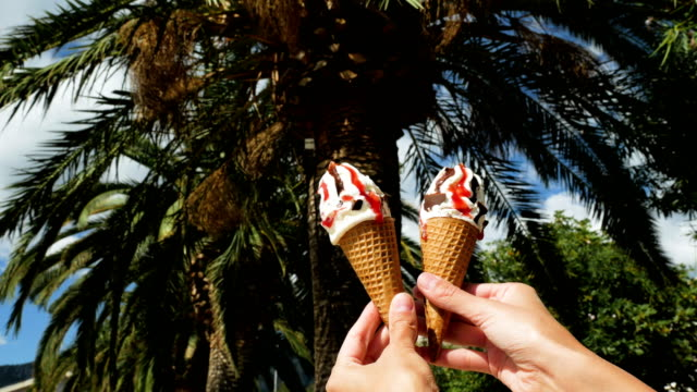 girl-holding-two-ice-creams-with-one-hand