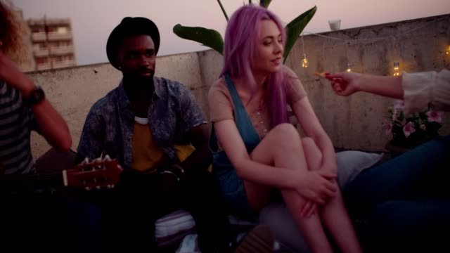 Multi-ethnic-hipster-friends-having-fun-at-rooftop-summer-party