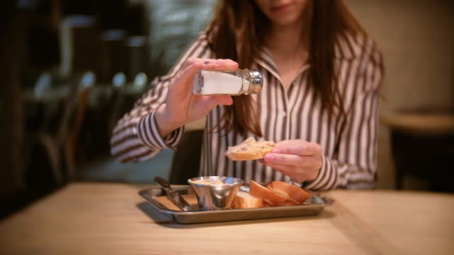 Woman-brunette-salt-sandwich-with-pate-in-cafe-