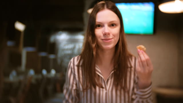 Young-beautiful-woman-brunette-eats-sandwich-with-pate-