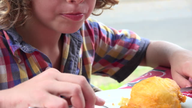Young-Boy-Eating-with-Fork