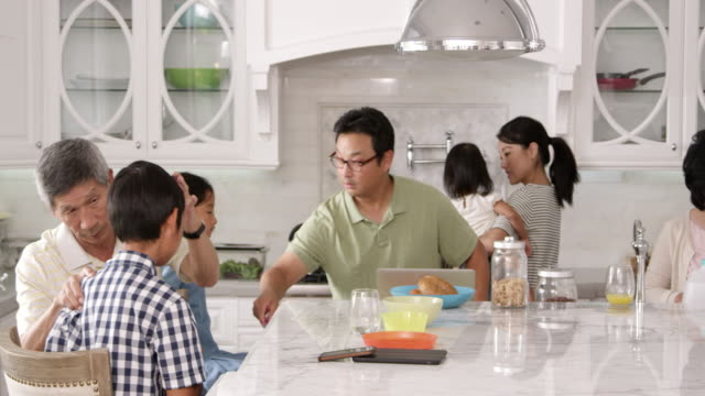 Extended-Family-Group-Eating-Breakfast-At-Home-Shot-On-R3D