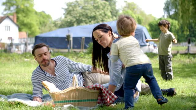 Slow-Motion-Sequence-Of-Family-Enjoying-Riverside-Picnic