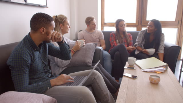 Students-Relaxing-In-Lounge-Of-Shared-Accommodation