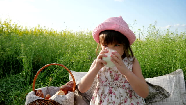 sweet-girl-beverage-from-dairy-products-Pleasure-on-child-s-face-milk-advertising-Healthy-food-for-children-little-female-child