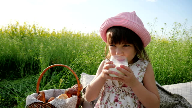 healthy-kid-drinks-milk-from-glass-sweet-girl-beverage-from-dairy-products-Pleasure-on-child-s-face-milk-advertising-Healthy-food