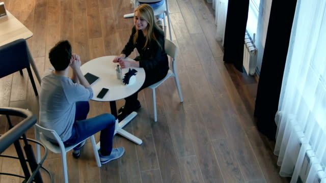 Couple-at-cafe-during-lunch-taking-offense-and-sitting-in-silence