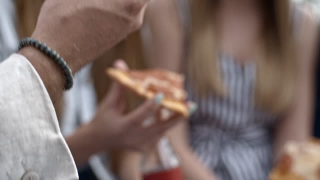 Close-Up-of-Hands-Holding-Pizza-and-Coke