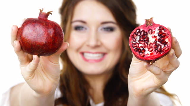 Woman-offering-pomegranate-fruit-on-white