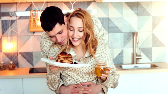 young-couple-in-morning-with-pancakes