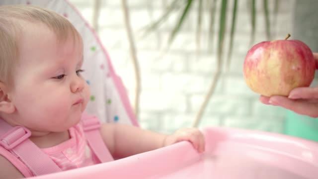 Toddler-girl-eating-fruit-Little-child-eating-red-apple