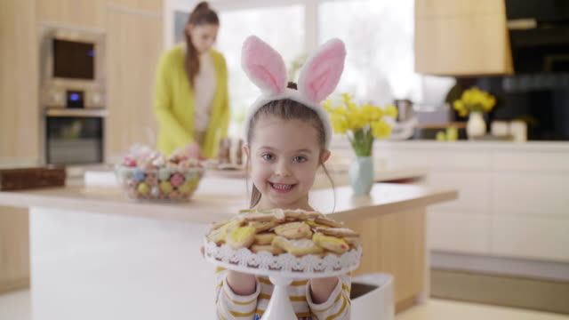 Cheerful-girl-in-rabbit-costume-with-cookie