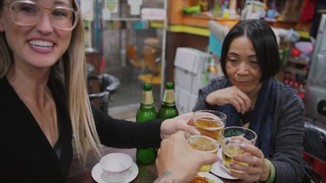 slow-motion-diverse-group-of-travels-make-a-cheers-over-dinner-at-a-Hong-Kong-restaurant