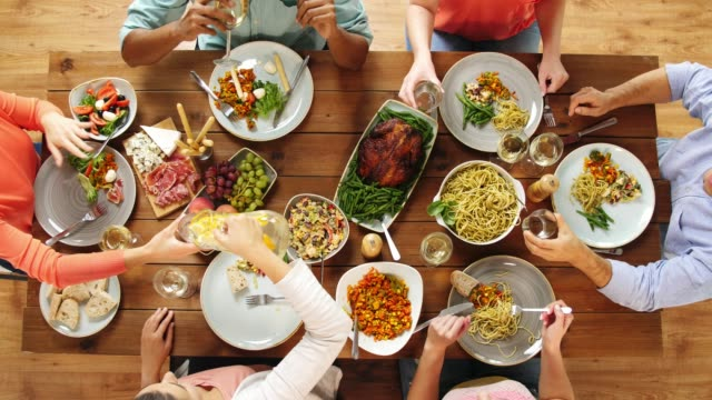 group-of-people-eating-at-table-with-food