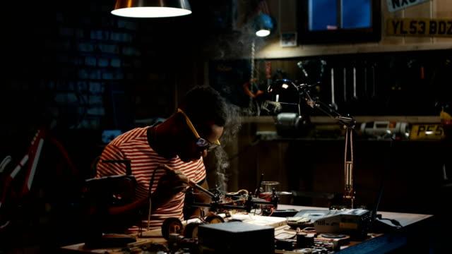 Man-repairing-a-drone