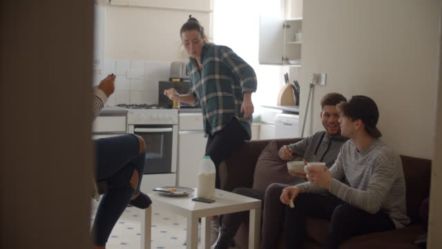 Group-Of-Students-Eating-Breakfast-In-Shared-House