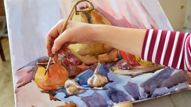 A-young-artist-in-an-art-workshop-draws-a-still-life-from-nature-in-watercolor