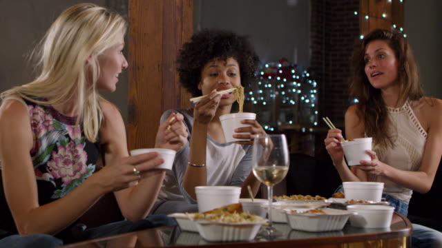 Three-female-friends-talking-and-eating-a-Chinese-take-away-shot-on-R3D