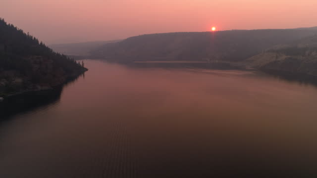 Sunset-Aerial-Over-Lake-Roosevelt-in-Forest-Fire-Smoke-Haze