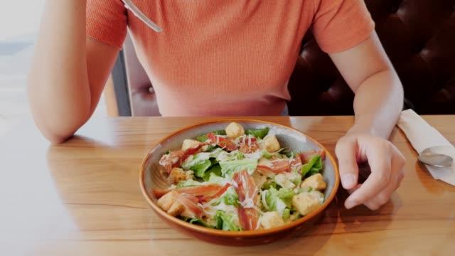 Young-woman-eating-salad-Healthy-Food