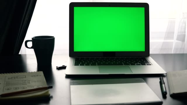 Laptop-with-green-screen-Programmer-s-workplace