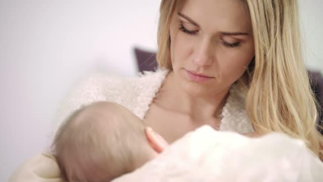 Young-mother-breast-feeding-new-born-child-Enjoy-motherhood