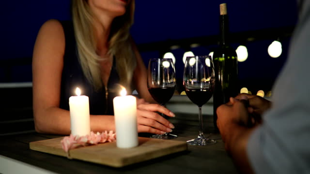 Young-beautiful-couple-having-romantic-dinner-on-rooftop