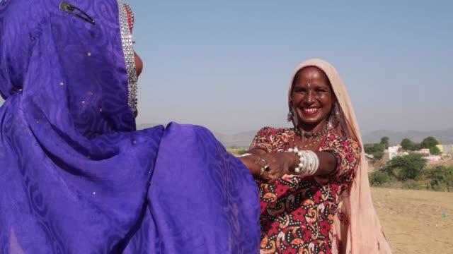 Nomadic-woman-dancing-in-front-of-Camels-at-Pushkar-Mela-festival-India