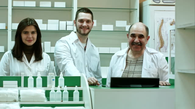 Portrait-of-a-pharmaceutical-team-smiling-and-looking-at-camera