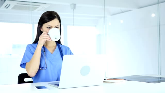 Doctor-Relaxing-and-Drinking-Coffee-at-Work