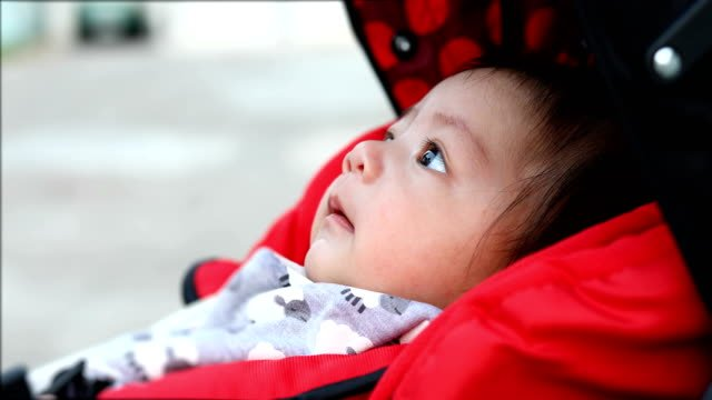 cute-boy-child-laughing-happy-smile-in-baby-stroller-carriage-seat