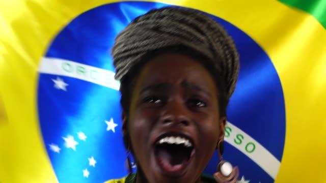 Brazilian-Young-Black-Woman-Celebrating-with-Brazil-Flag