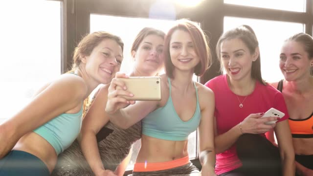 group-of-women-communicate-and-make-selfies