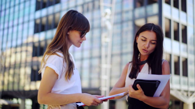 Business-colleagues-successful-meeting-and-working-together-on-an-idea-on-paper-near-business-office-businesswoman-people-discussing-the-latest-news-in-the-world-markets