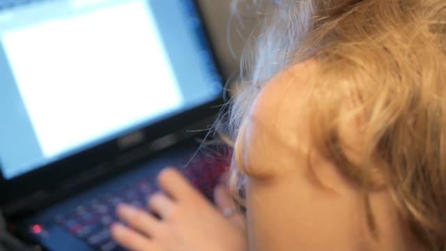 Girl-Typing-on-Laptop