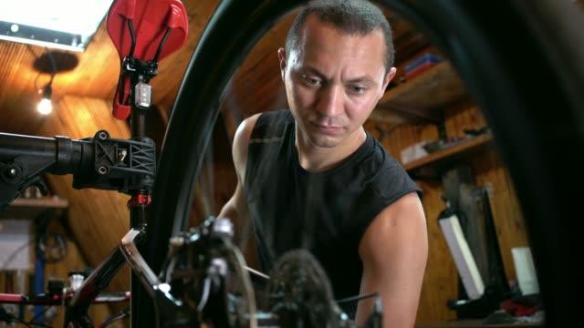 bicycle-mechanic-repairing-