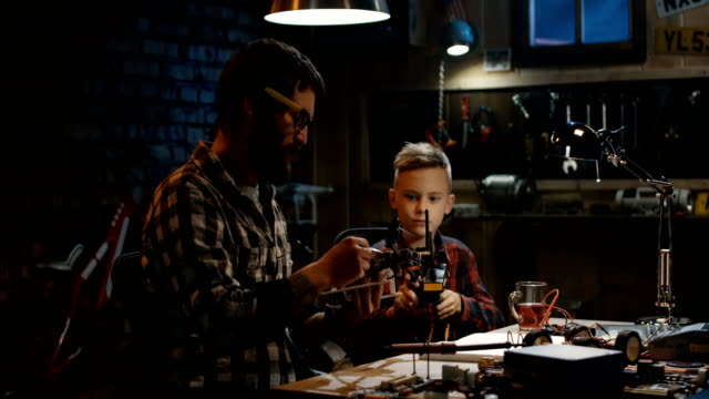 Father-and-son-repairing-a-drone