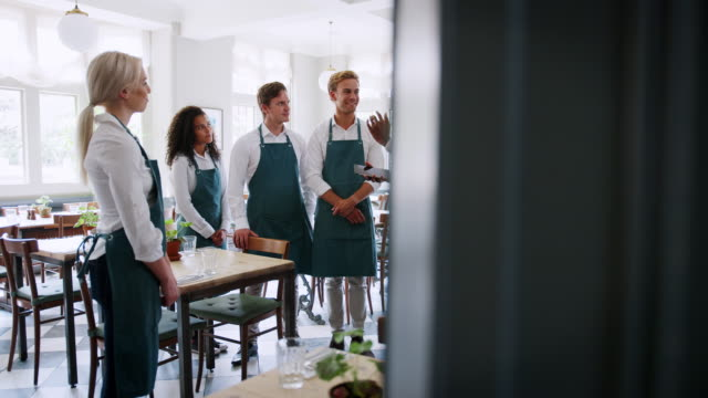 Team-Meeting-Of-Management-And-Staff-Before-Restaurant-Opens