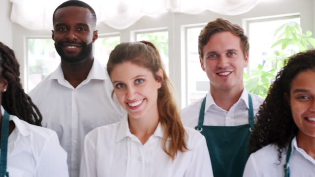 Portrait-Of-Restaurant-Management-And-Staff-Standing-In-A-Line