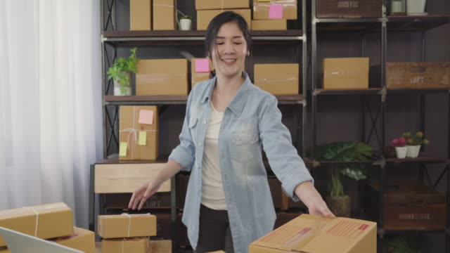 Beautiful-smart-Asian-young-entrepreneur-business-woman-owner-of-SME-feeling-happy-dancing-while-see-business-achievement-Small-business-owner-at-home-office-concept-