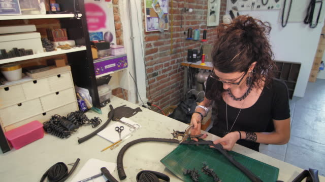 Young-eco-jewelry-maker-creating-artwork-in-her-atelier