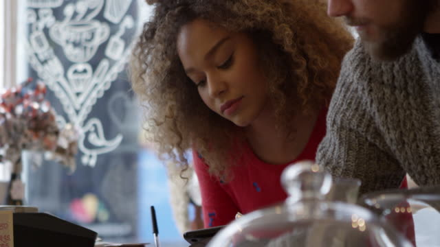 Young-Couple-Working-In-Coffee-Shop-Shot-On-R3D
